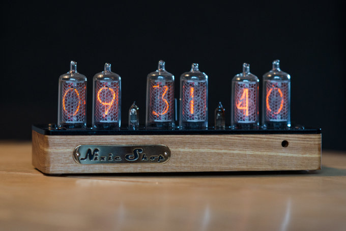 Nixie clock in solid wooden enclosure with a plastic bottom cover