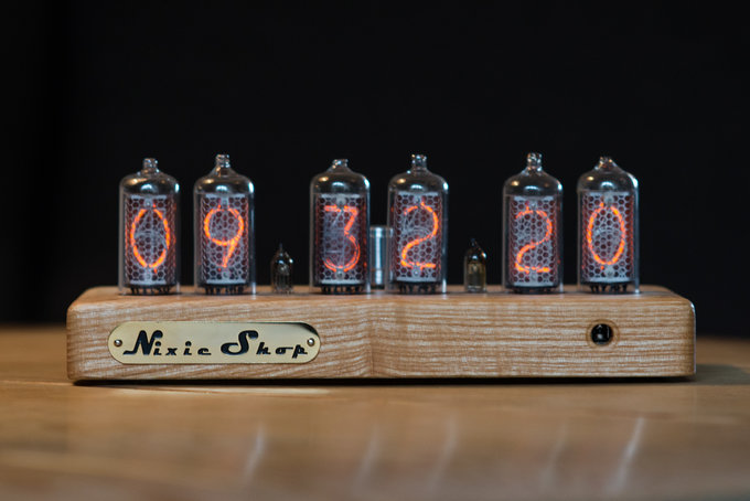 Nixie clock in solid wooden enclosure with a plastic top cover